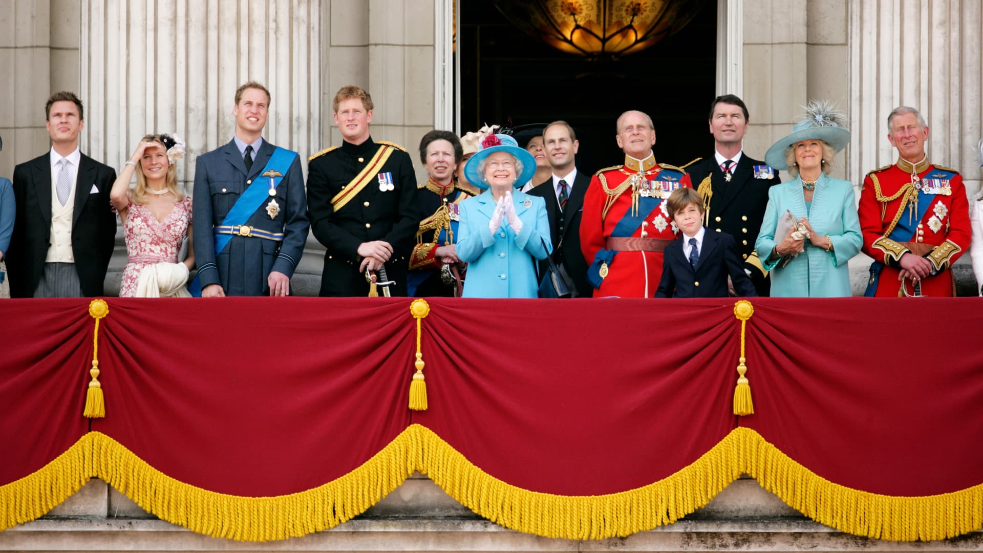(L-R) George Gilman, Lady Rose Gilman (formerly Lady Rose Windsor), Prince William, Prince Harry, Princess Anne, Queen Elizabeth, Prince Edward, Prince Philip, Charles Armstrong Jones, Adm. Tim Laurence, Camilla and Prince Charles watch the traditional fly-past on the balcony of Buckingham Palace during the annual Queens Colour of First Battalion Grenadier Guards on June 13, 2009, in London, England.