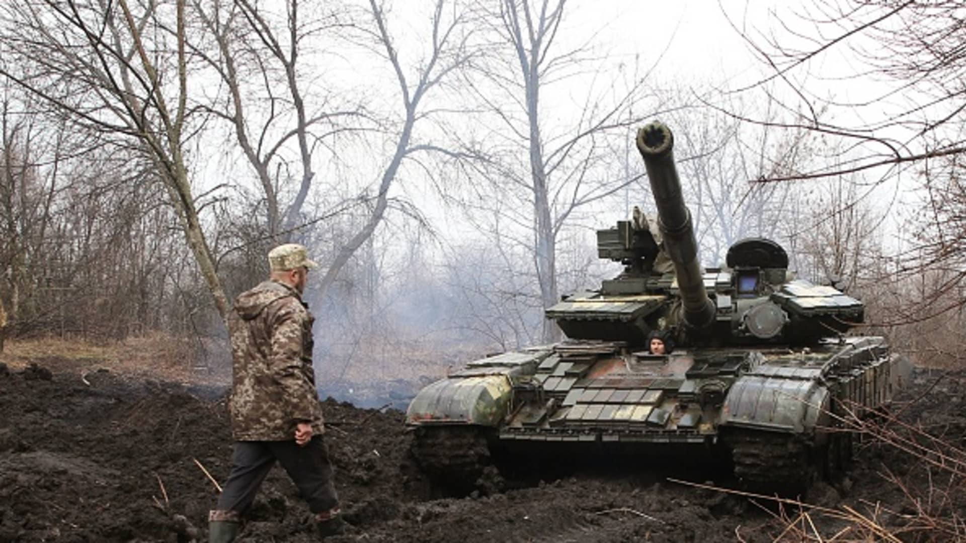 Ukrainian servicemen work on their tank close to the front line with Russian-backed separatists near Lysychansk, Lugansk region on April 7, 2021.
