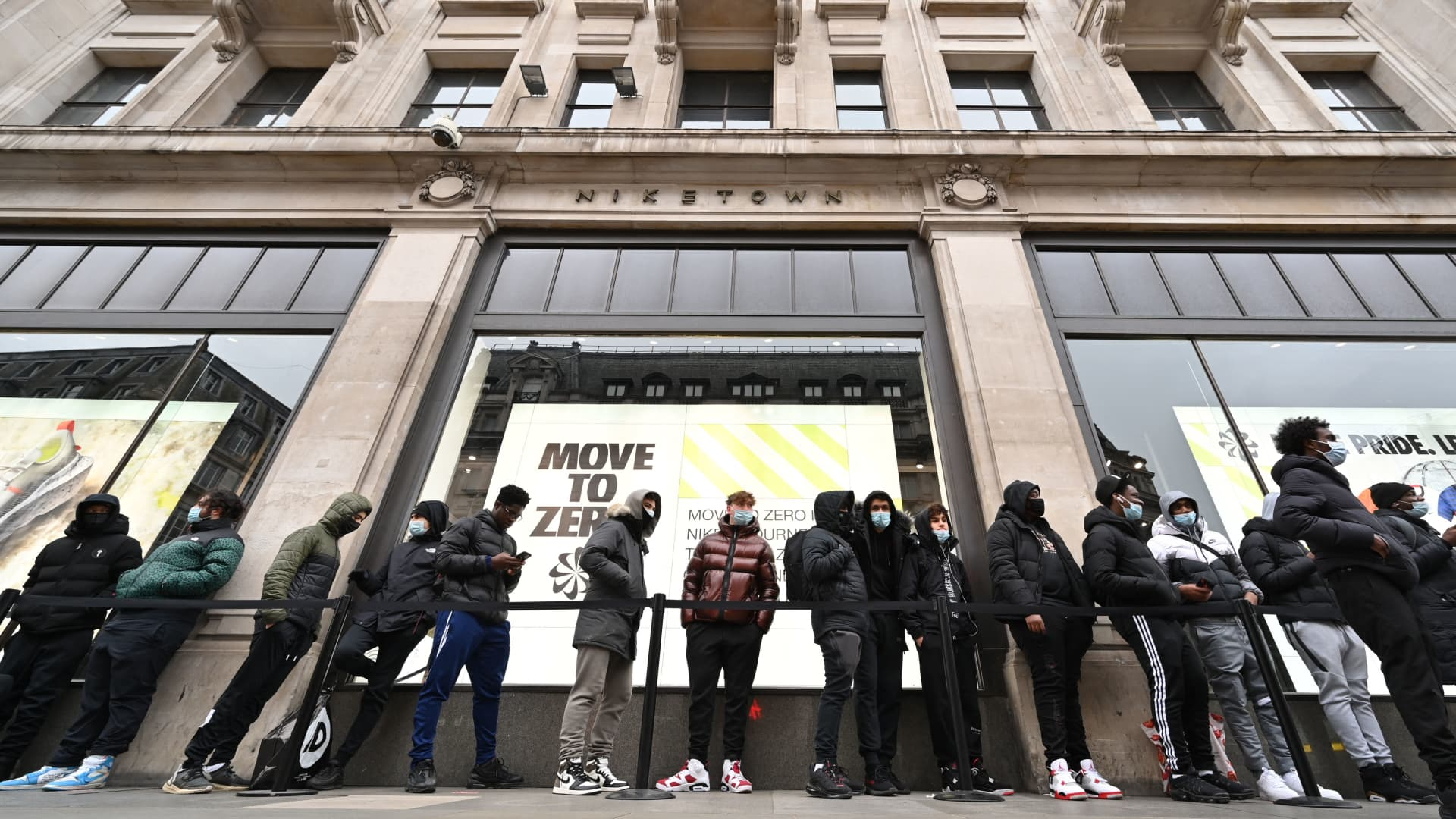 Shoppers queue outside a Nike store in central London as coronavirus restrictions are eased across the country on April 12, 2021.
