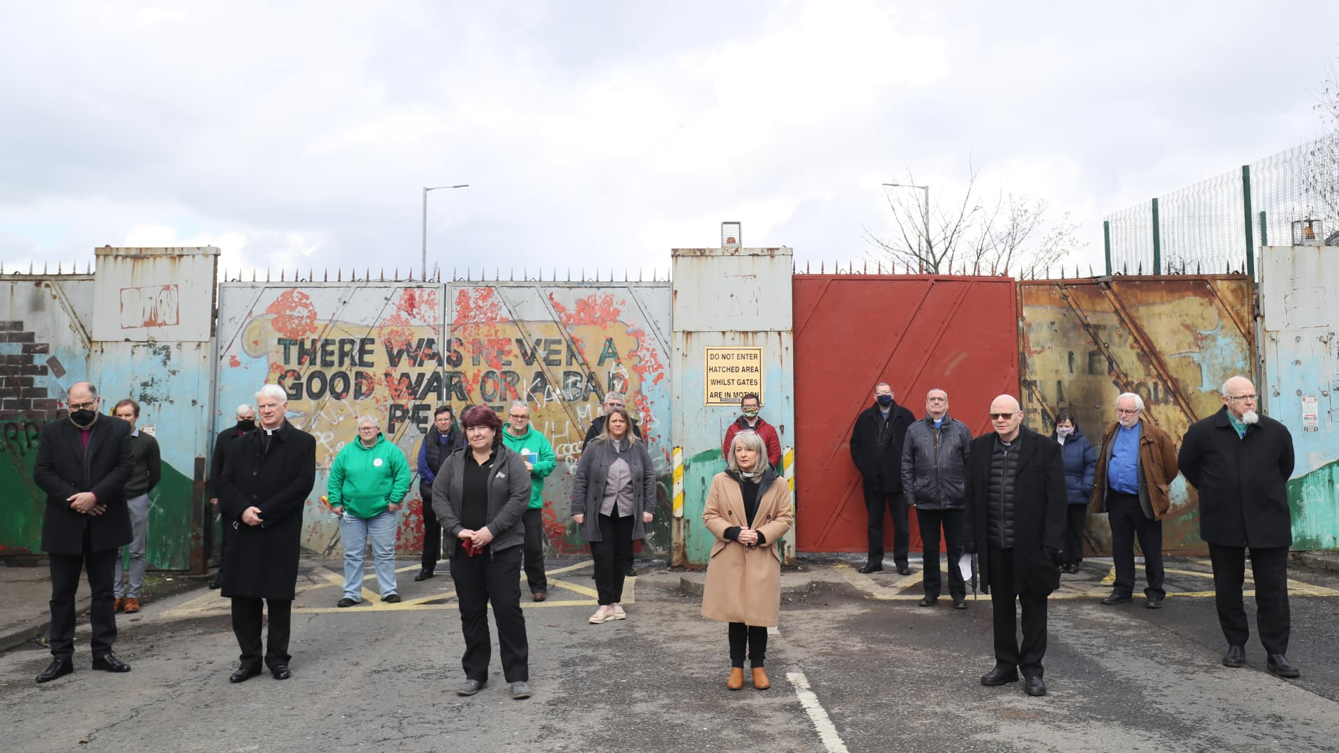 BELFAST - Members of the clergy at the peace wall on Lanark Way in Belfast following a Ecumencial service in response to the recent riots and violence in the city