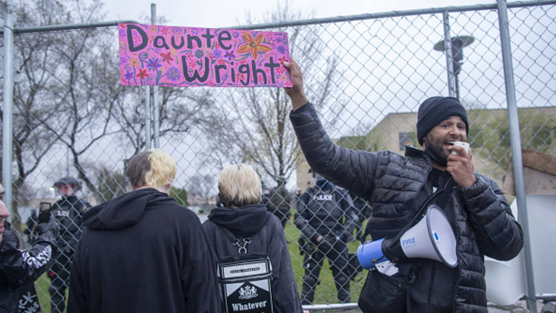 Activist Jonathan Mason holds a Daunte Wright sign in front of the crowd of protesters that gathered to protest the police killing of Daunte Wright in Brooklyn Center, Minnesota, U.S., on April 13, 2021.