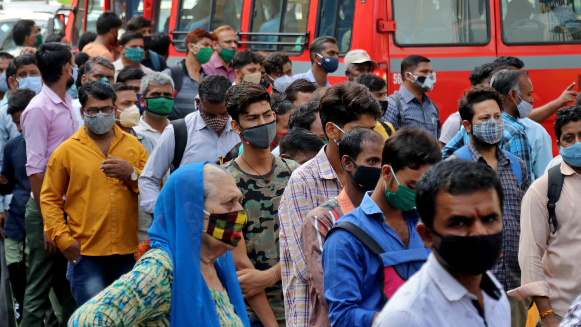 People wait to board passenger buses during rush hour at a bus terminal amidst the spread of the coronavirus disease (COVID-19), in Mumbai, India, April 5, 2021.