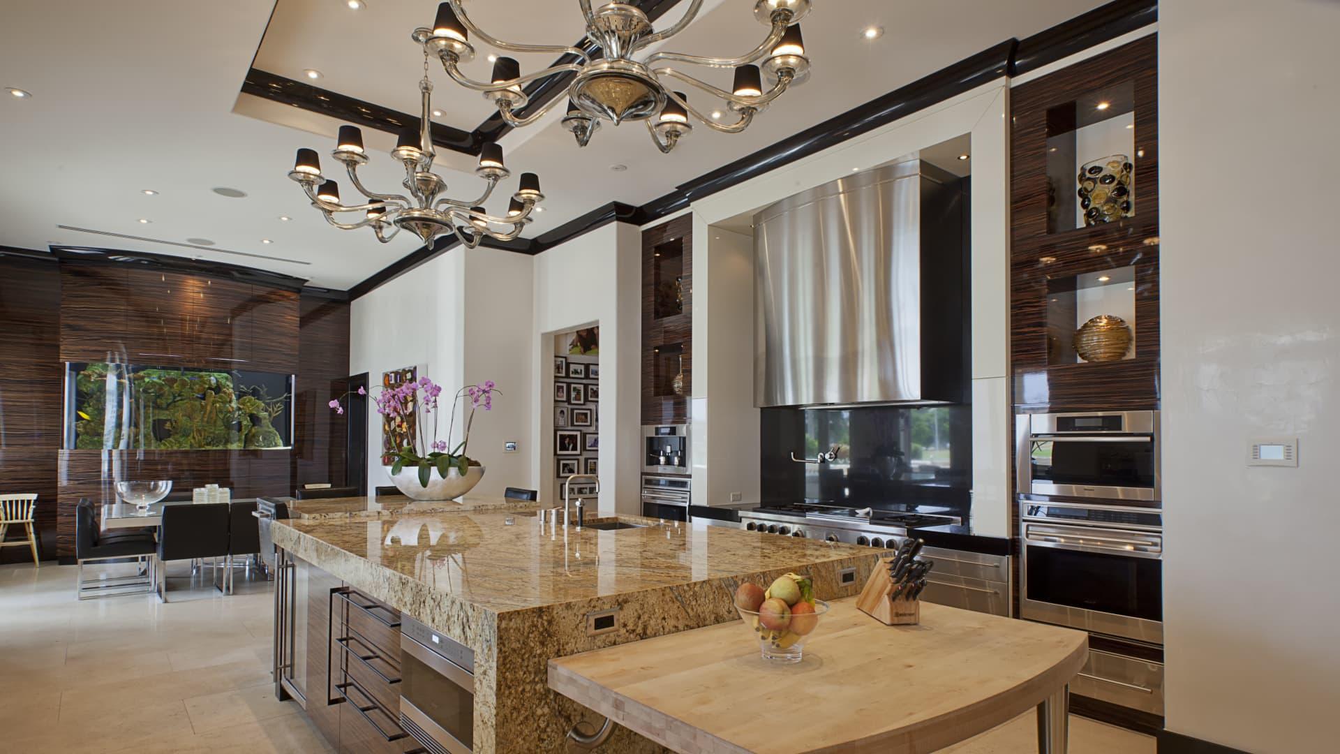 Villa Magnolia's kitchen includes a 750-gallon saltwater fish tank.