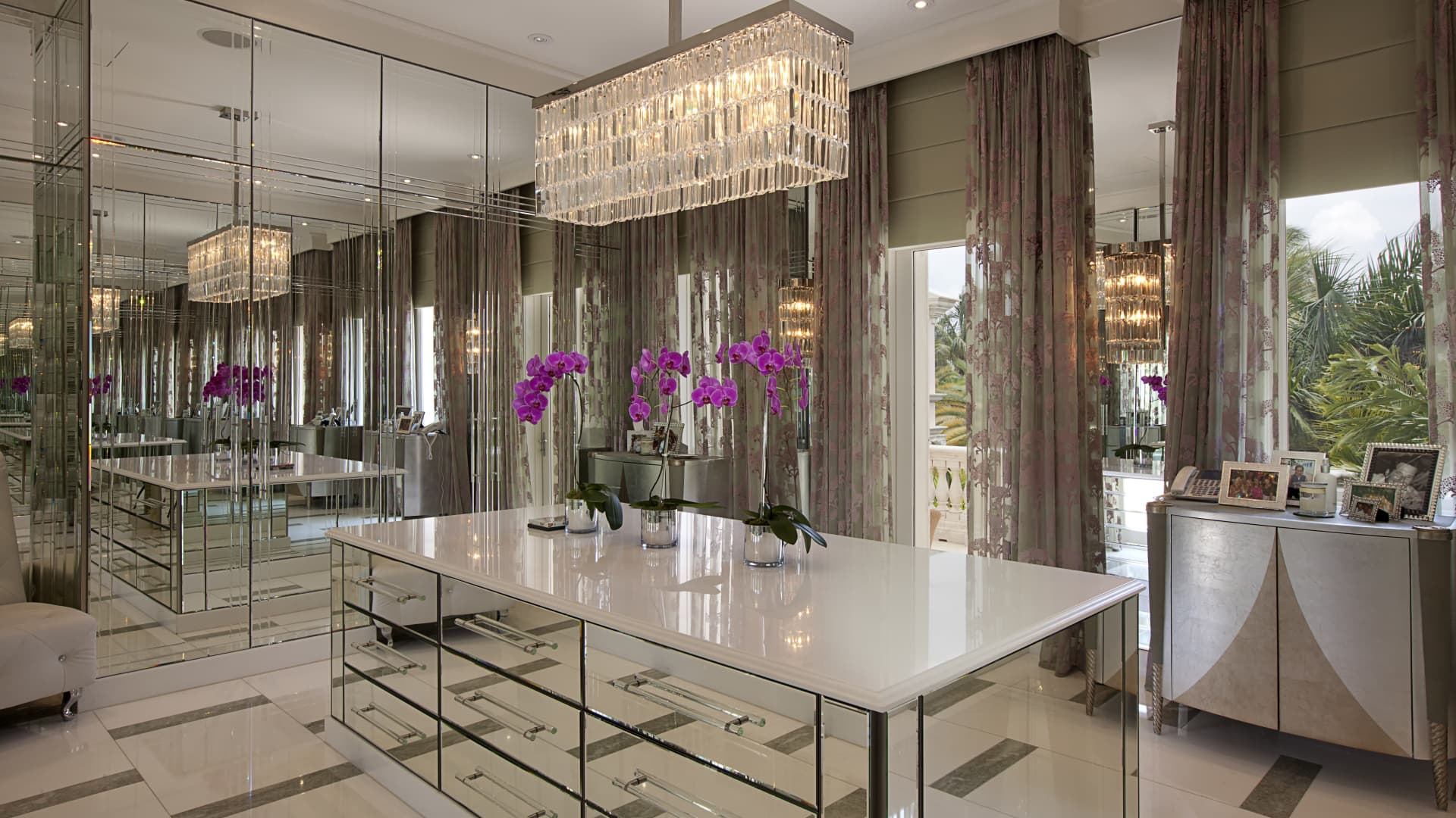 The stunning closet has floor-to-ceiling mirrors.