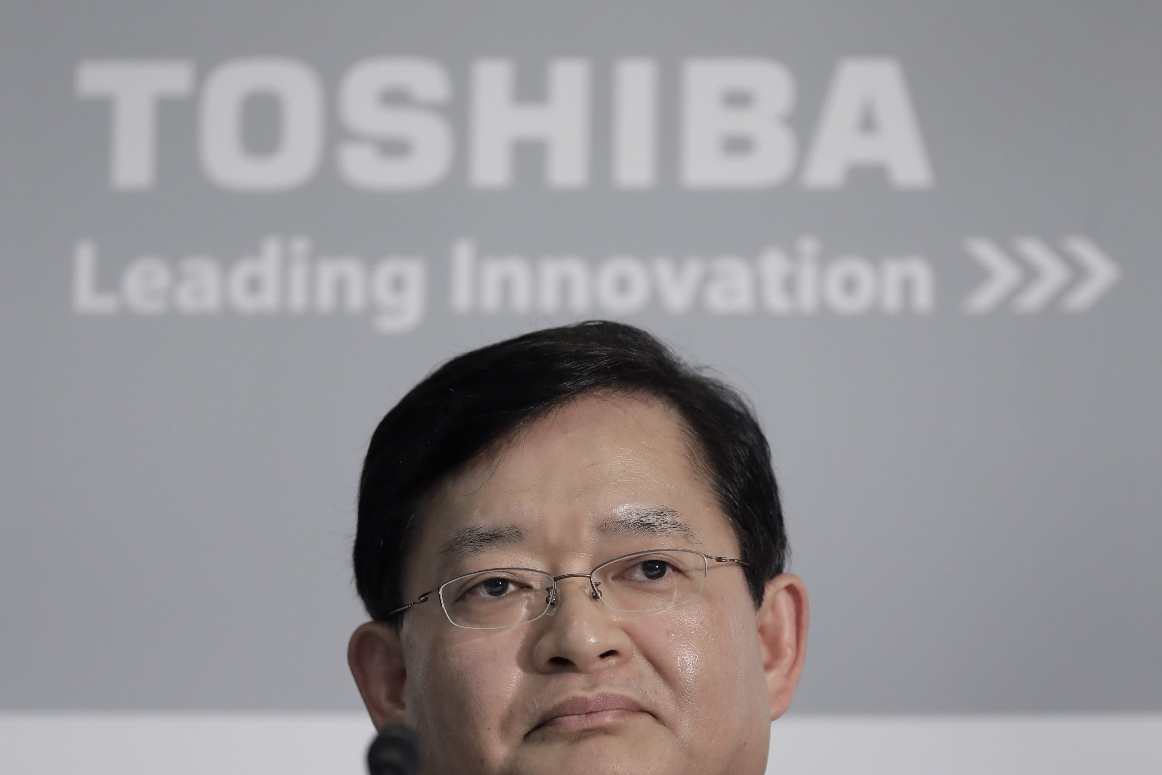 Controversial Toshiba CEO steps down, shares jump on bidding war expectations
