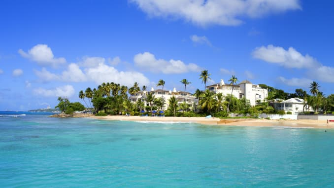 The hotels, palm trees and crystalline waters of Barbados.
