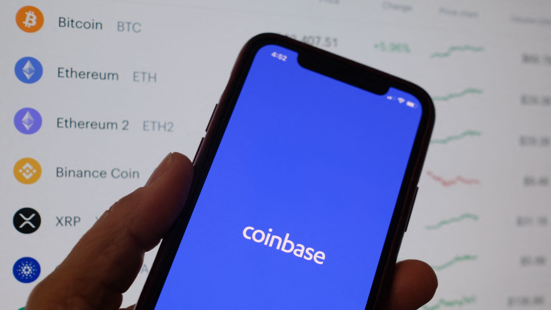 The Coinbase logo shown on a smartphone.