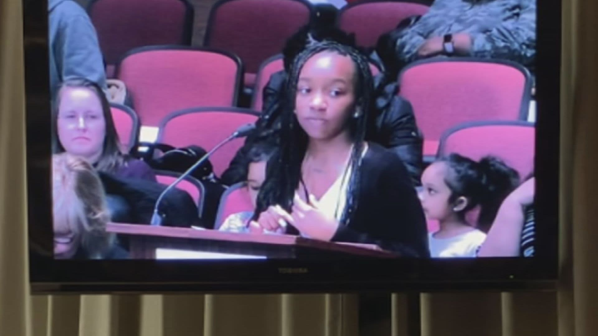High school student Zoe McCall testifies before her Board of Education about the importance of financial literacy in March 2020.