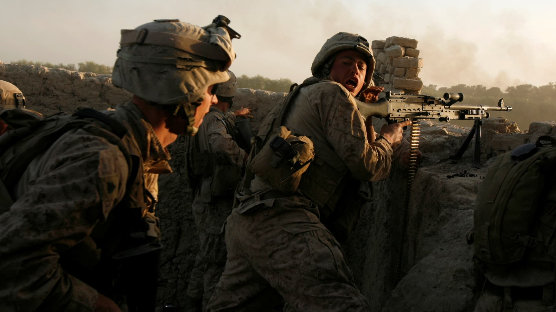 U.S. Marines fire during a Taliban ambush as they carry out an operation to clear an area in Helmand province, Afghanistan, October 9, 2009.