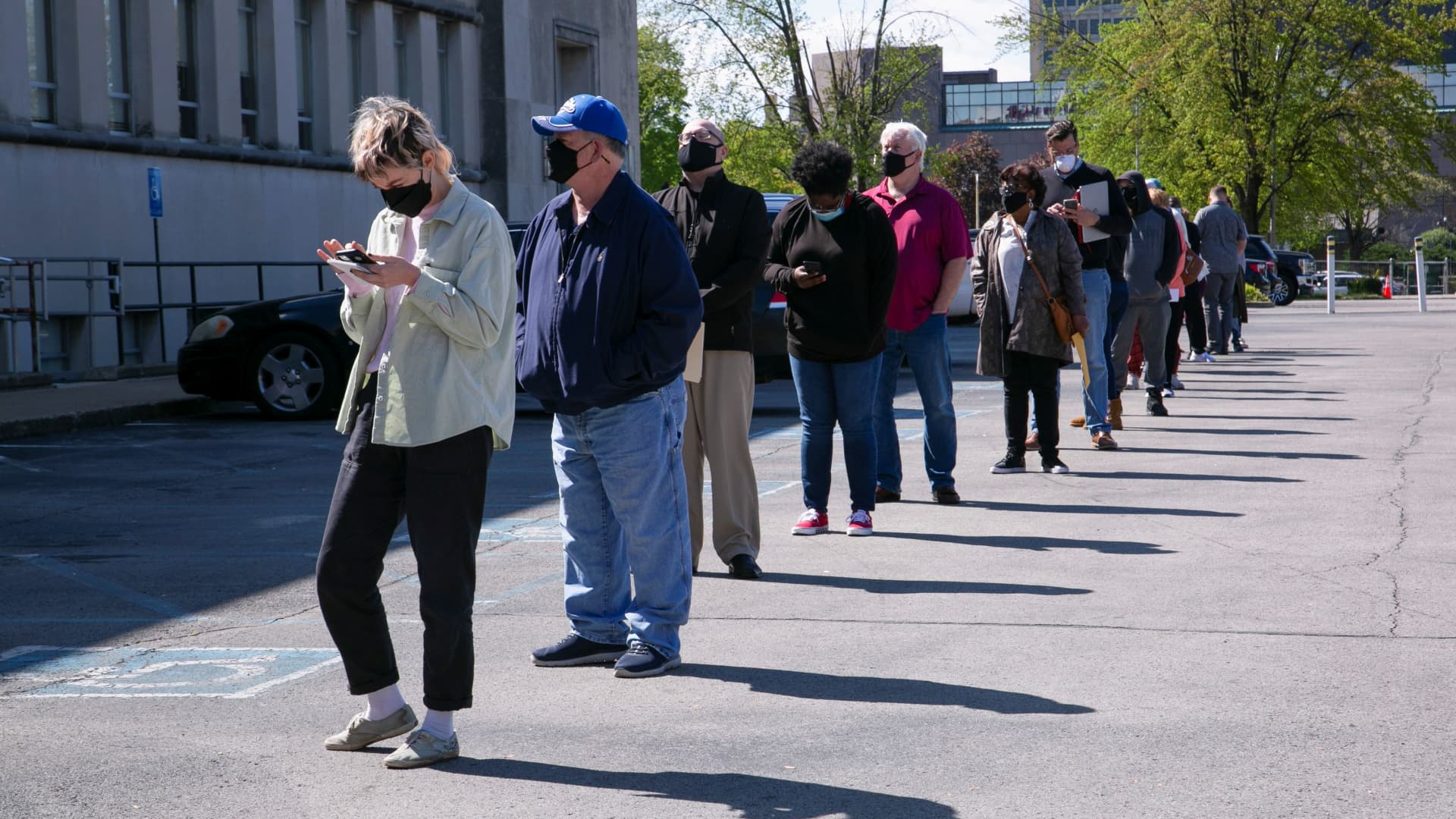 People line up outside a newly reopened career center for in-person appointments in Louisville, Kentucky, on April 15, 2021.