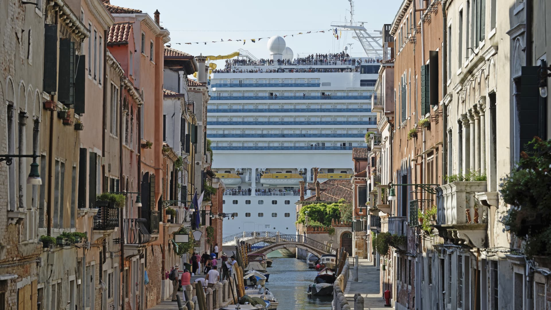 A cruise liner passes by the historic canals of Venice, Italy.