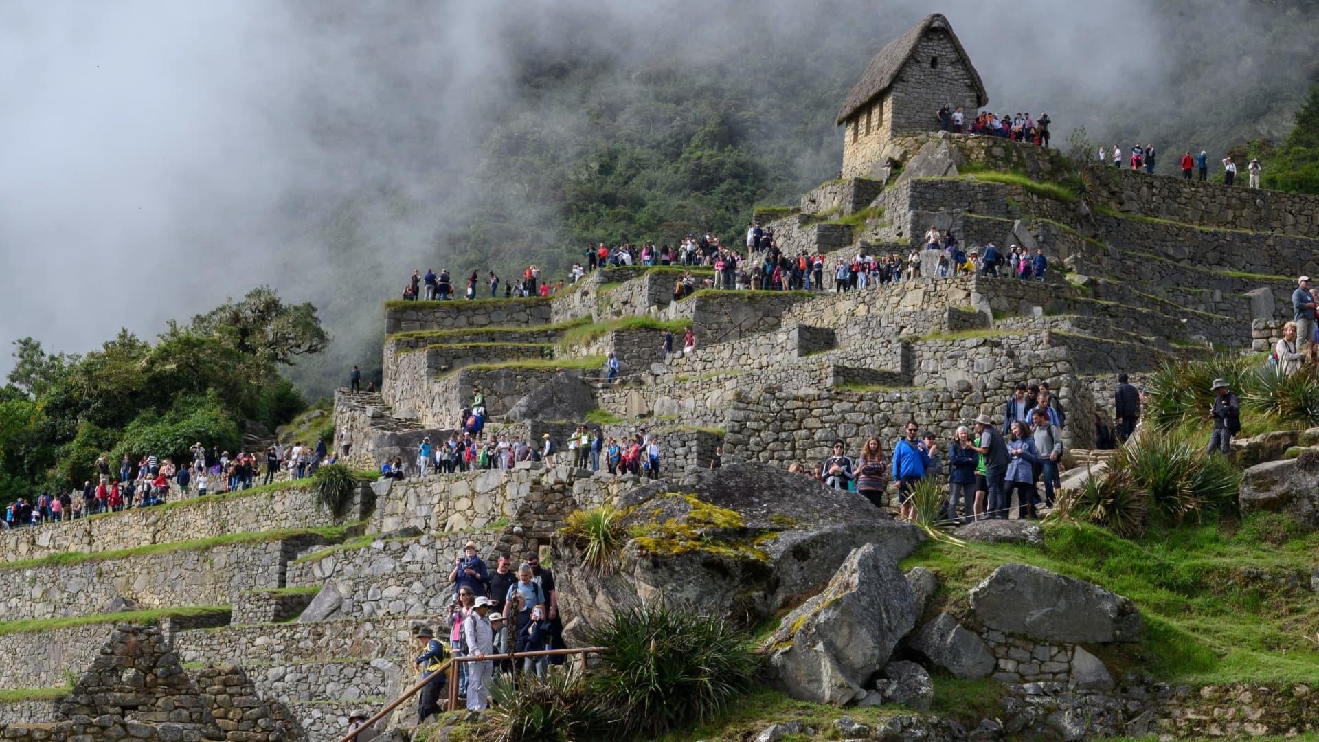 Tourists visit the Machu Picchu complex on April 24, 2019.