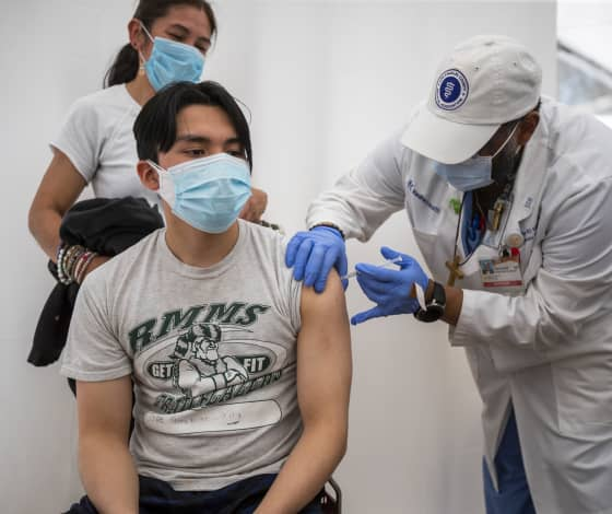 Vaccinations in the U.S. are surging with many states nearing half of residents jabbed