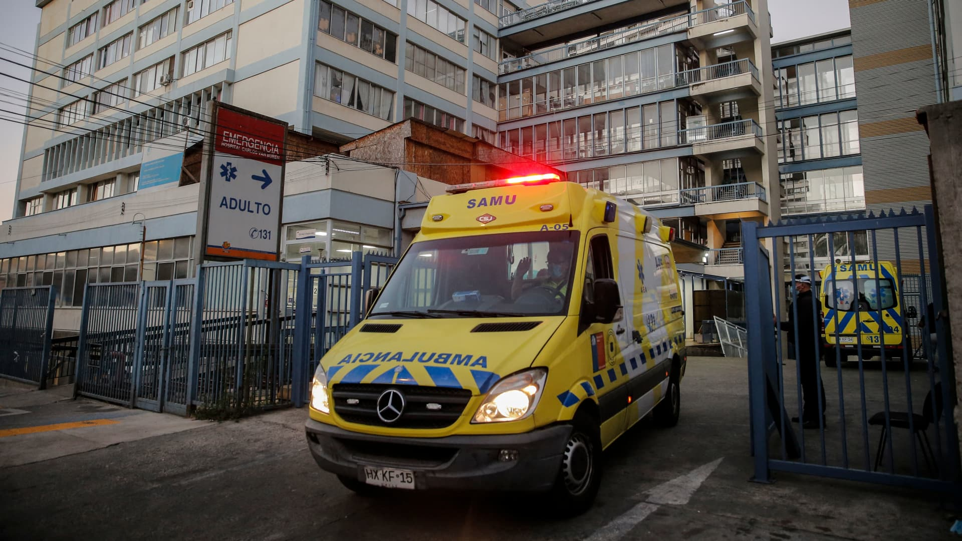 An ambulance leaves the Carlos Van Buren Hospital, which is overwhelmed by the large number of Covid-19 positive cases, in Valparaiso, Chile on April 6, 2021.