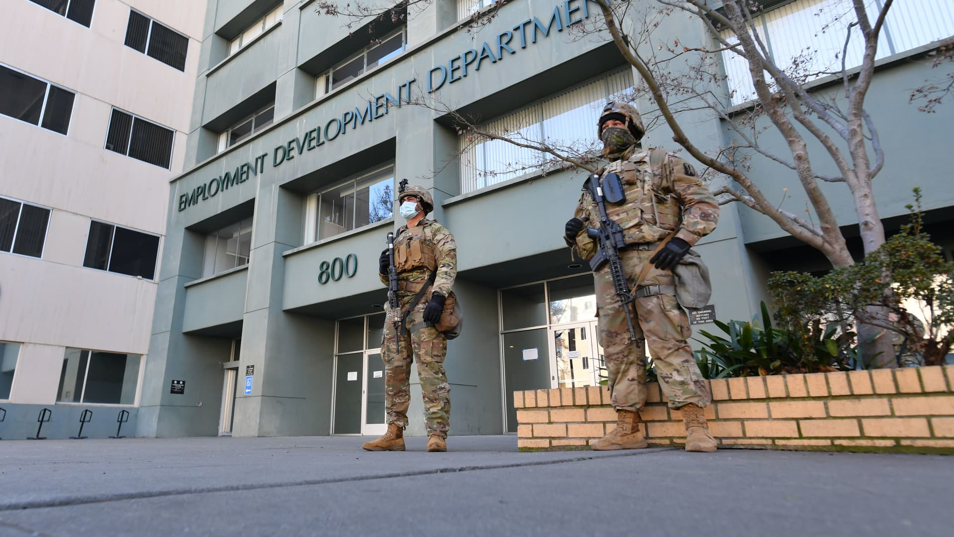 National Guard members in front of an Employment Development Department building near the State Capitol in Sacramento, Calif., on Jan. 17, 2021.