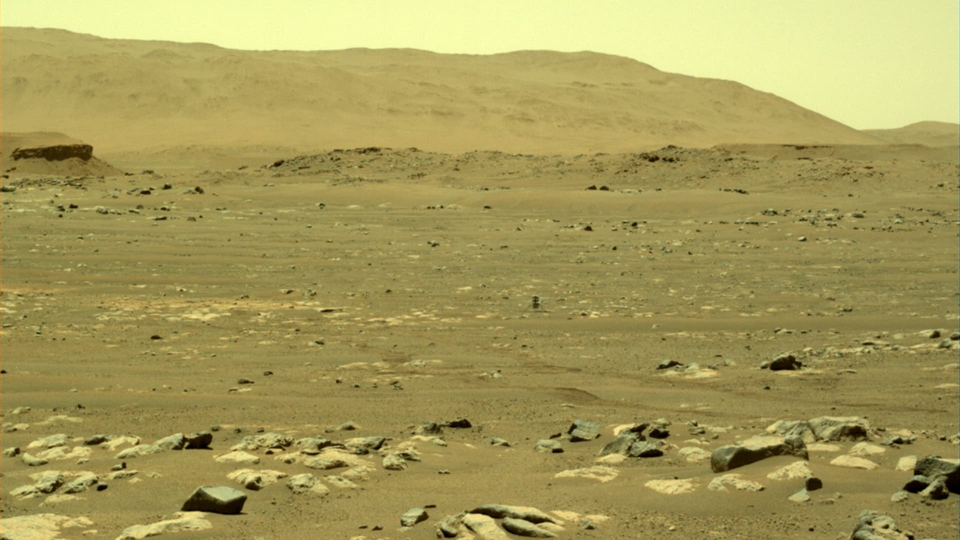 NASA helicopter Ingenuity back on the surface of Mars after its first flight on April 19, 2021, captured by a camera on the Perseverance rover.