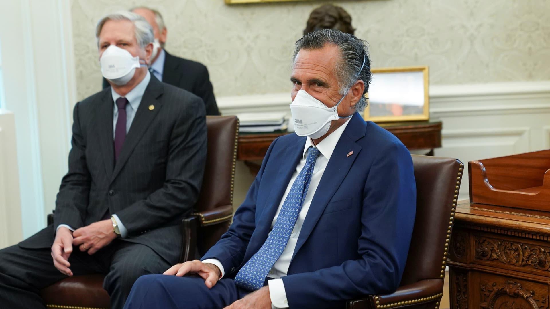 Senators Mitt Romney (R-UT) and John Hoeven (R-ND) listen as U.S. President Joe Biden holds a bi-partisan meeting on the American Jobs Plan at the White House in Washington, U.S., April 19, 2021.
