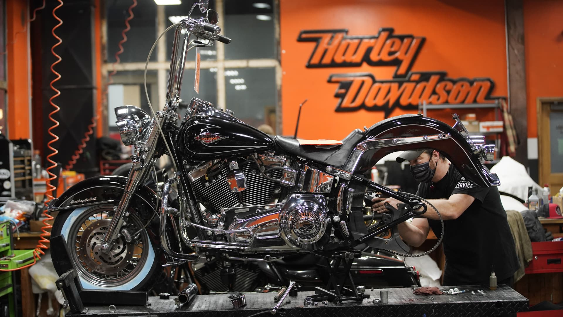 A mechanic works on a motorcycle at a Harley-Davidson showroom and repair shop in Lindon, Utah, U.S., on Monday, April 19, 2021.