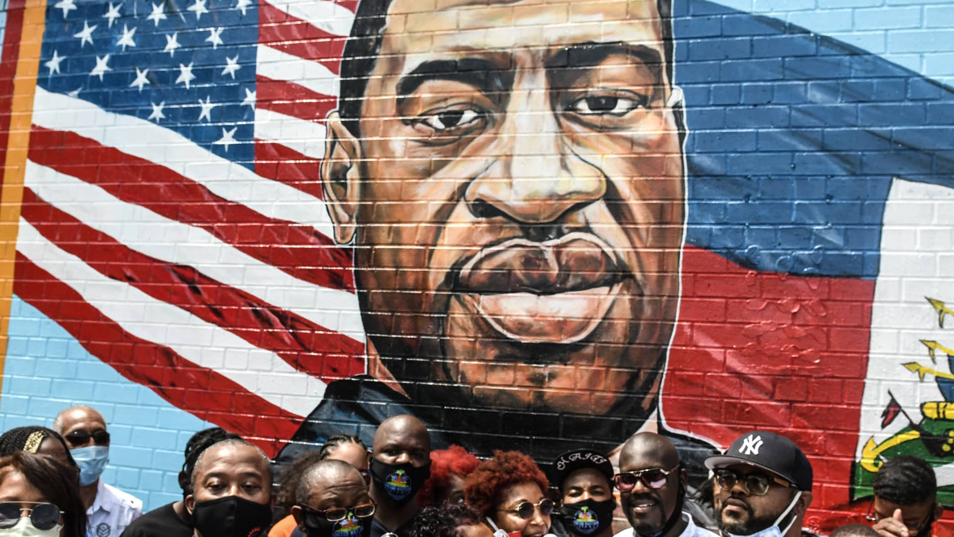 Terrance Floyd (R), the brother of George Floyd, attends a unveiling of a mural painted by artist Kenny Altidor depicting George Floyd on a sidewall of CTown Supermarket on July 13, 2020 in Brooklyn, New York City.
