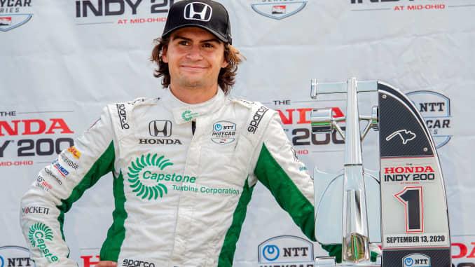 Colton Herta menunggu di stand penghargaan usai memenangi balapan mobil IndyCar Series, di Mid-Ohio Sports Car Course, Minggu, 13 September 2020, di Lexington, Ohio.