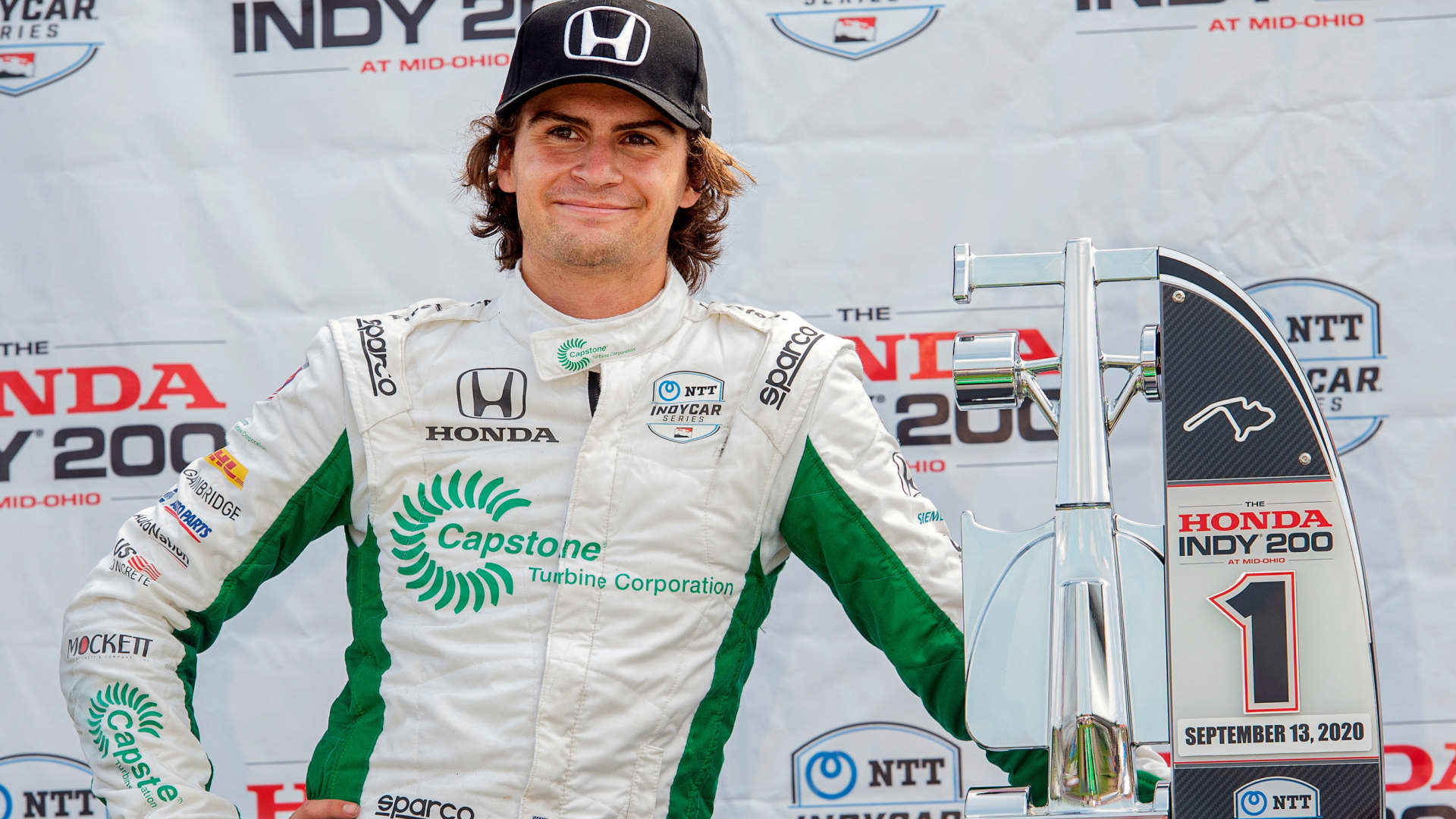 Colton Herta waits on the award stand after winning the IndyCar Series auto race, at Mid-Ohio Sports Car Course, Sunday, Sept. 13, 2020, in Lexington, Ohio.
