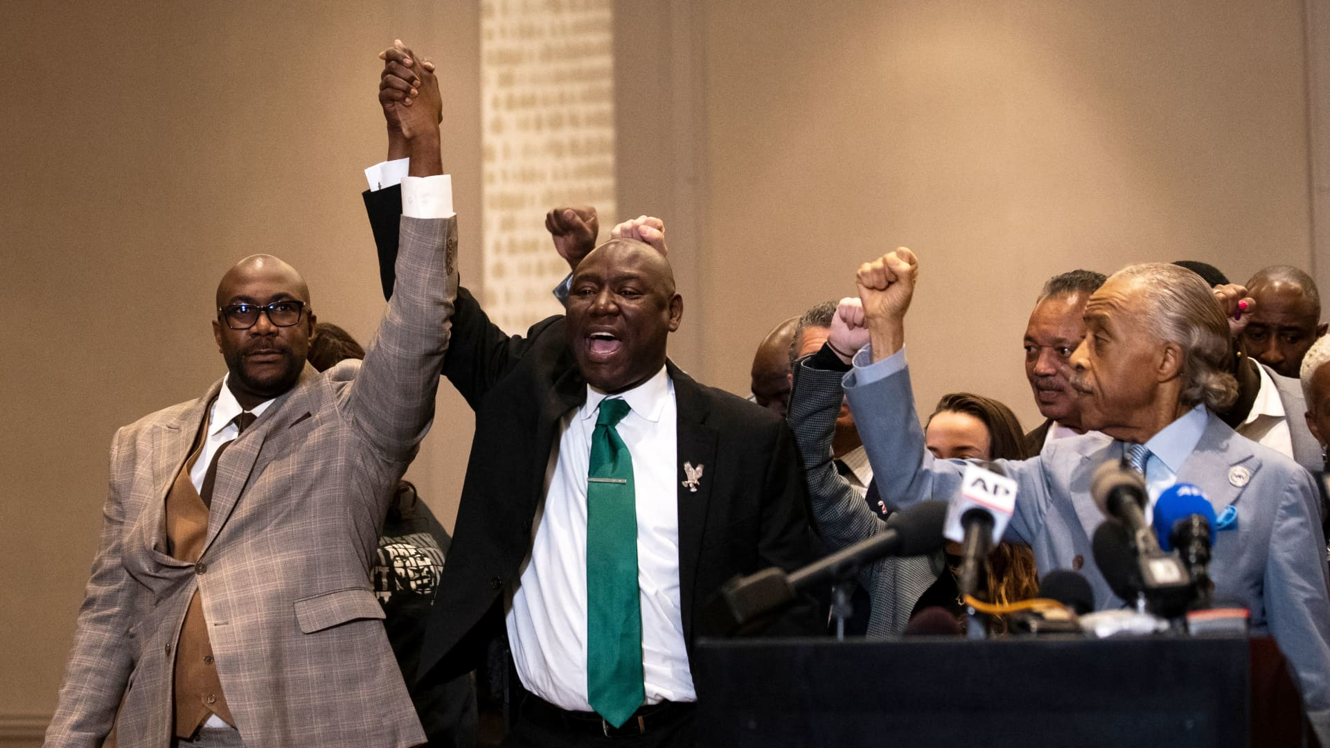 Philonise Floyd (L), Attorney Ben Crump (C) and Reverend Al Sharpton (R) react following the verdict in the trial of former police officer Derek Chauvin in Minneapolis, Minnesota on April 20, 2021.