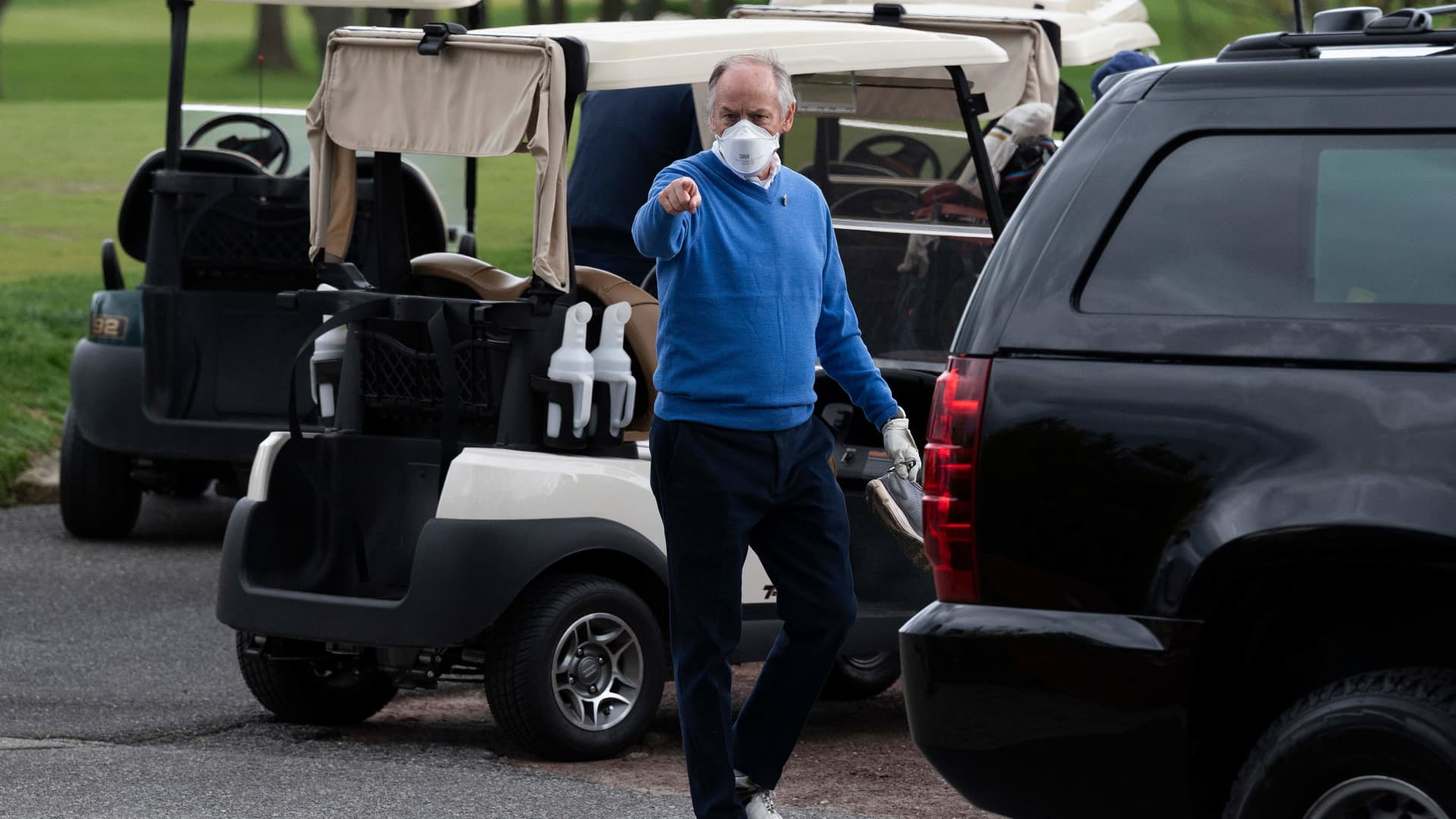 Counselor to the President Steve Ricchetti (C) gestures after playing a round of golf with US President Joe Biden at Wilmington Country Club in Wilmington, Delaware on April 17, 2021.