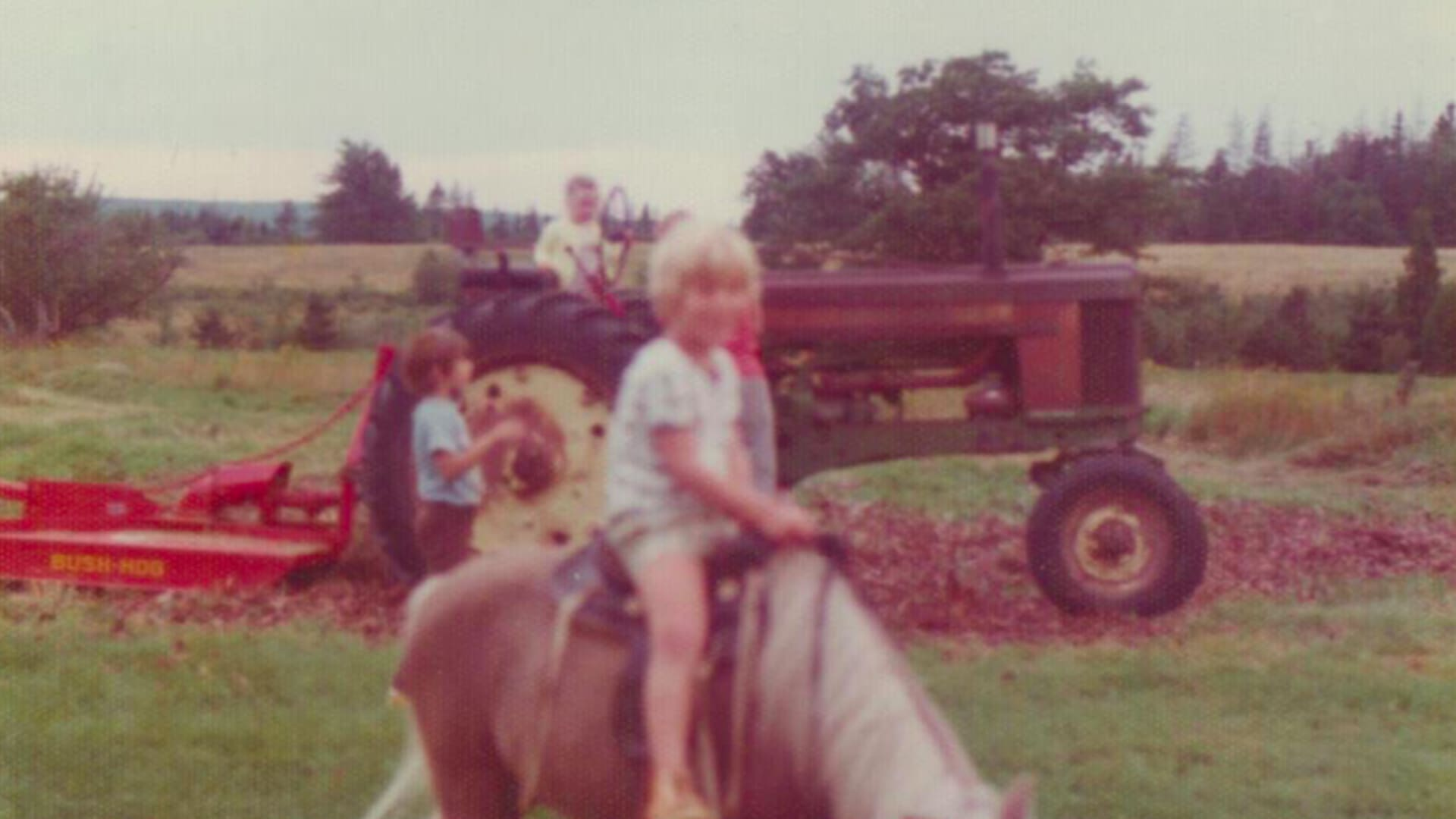 Ethan Brown (center) as child at his family's farm in Appalachia