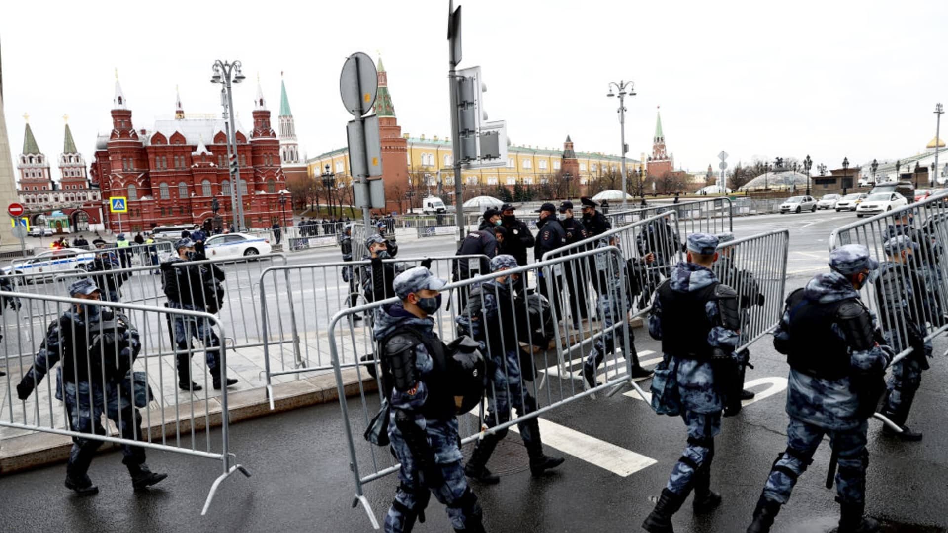 Russian police officers stand guard around the Kremlin Palace and Red Square on April 21, 2021.