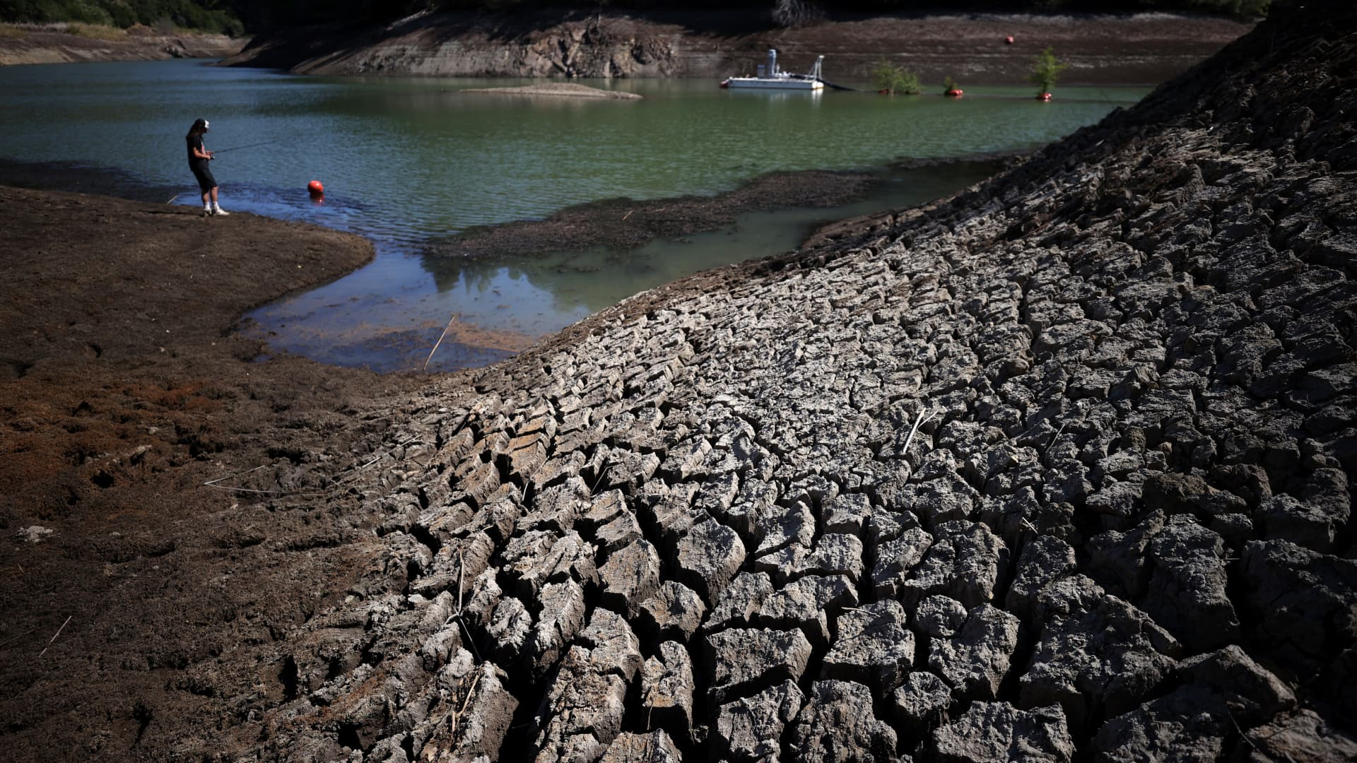 Dry cracked earth is visible along the banks of Phoenix Lake on April 21, 2021 in Ross, California.