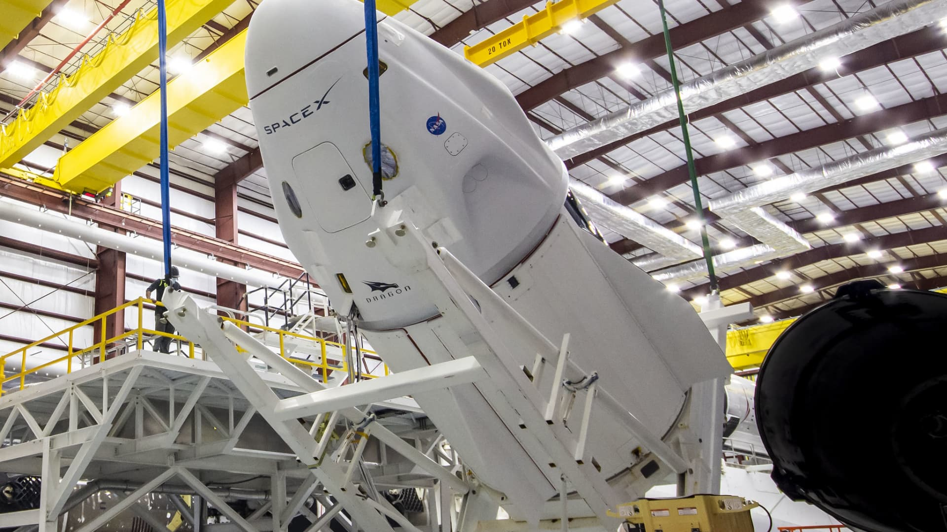 SpaceX's Crew Dragon, named Endeavour, is lifted and mated to the SpaceX Falcon 9 rocket at NASA Kennedy Space Center's Launch Complex 39A beginning April 13, 2021.