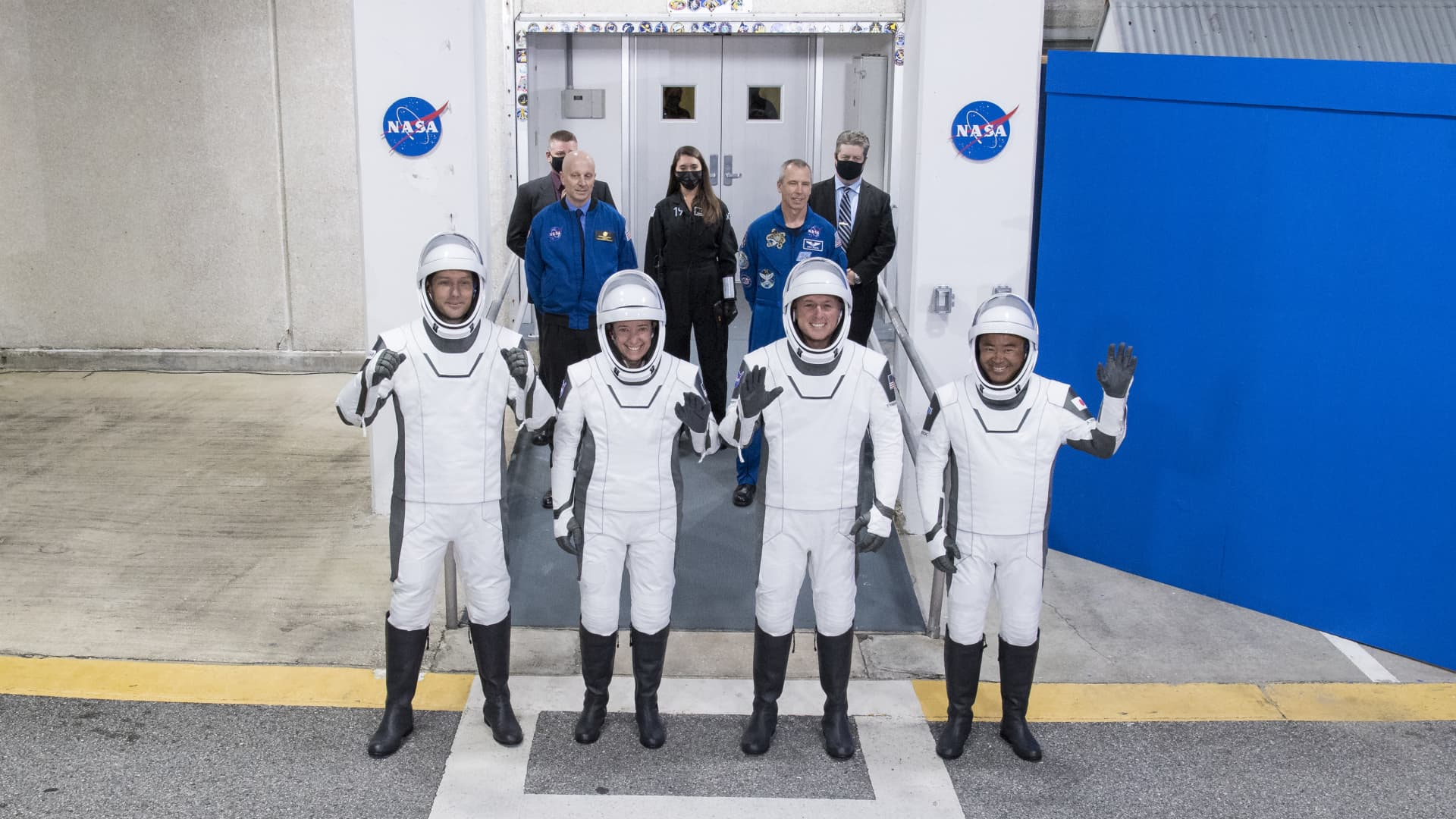 In this handout image provided by NASA, (L-R) ESA (European Space Agency) astronaut Thomas Pesquet, NASA astronauts Megan McArthur and Shane Kimbrough, and Japan Aerospace Exploration Agency (JAXA) astronaut Akihiko Hoshide, wearing SpaceX spacesuits, prepare to depart the Neil A. Armstrong Operations and Checkout Building for Launch Complex 39A to board the SpaceX Crew Dragon spacecraft for the SpaceX Crew-2 mission at NASA's Kennedy Space Center on April 23, 2021, in Cape Canaveral, Florida.
