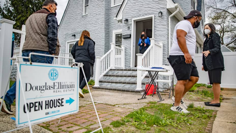 Real estate agents Rosa Arrigo, center, and Elisa Rosen, right, work an open house in West Hempstead, New York on April 18, 2021.