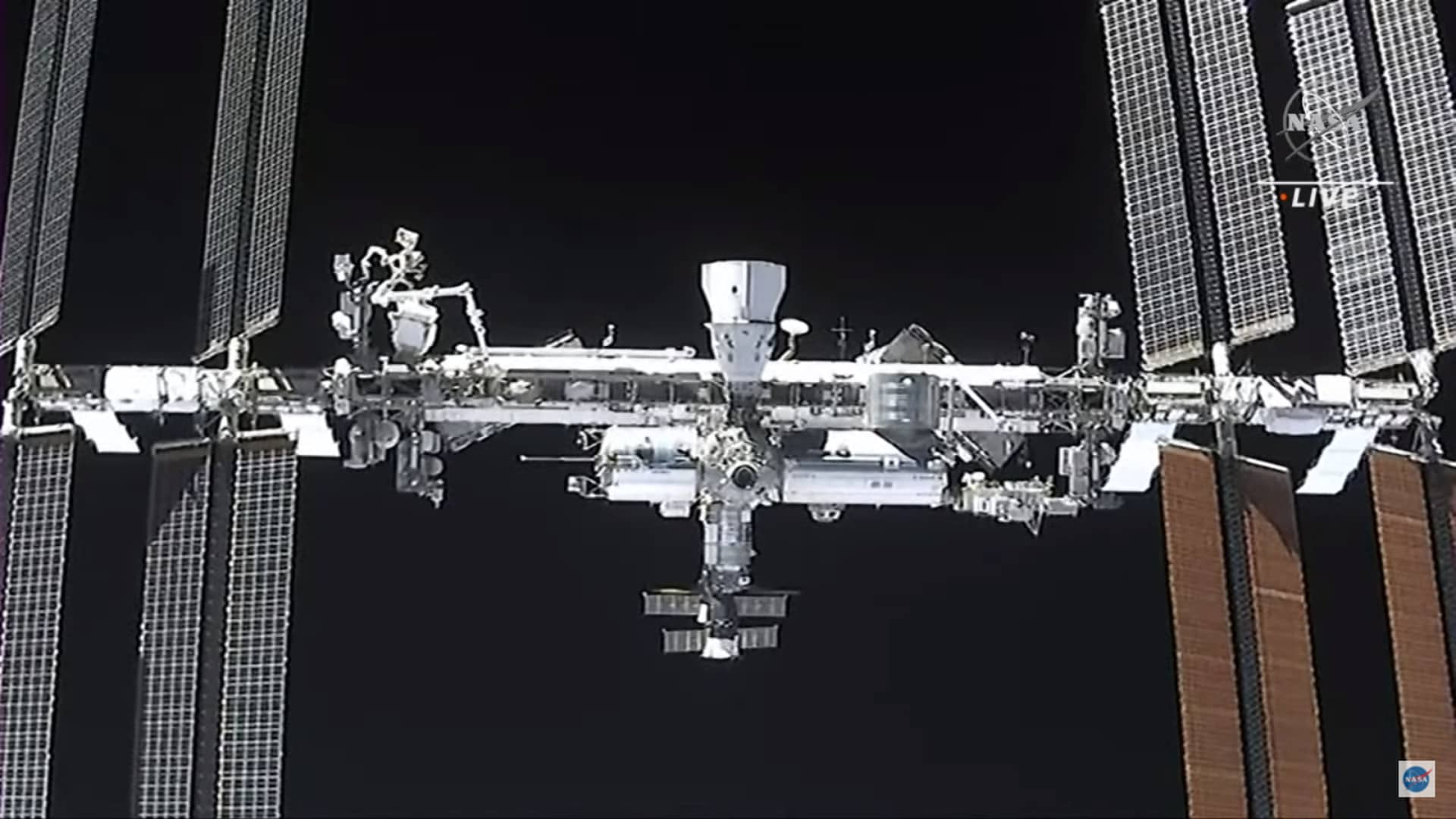 The view from SpaceX's Crew Dragon spacecraft Endeavour of the International Space Station, as well as the company's Crew Dragon spacecraft Resilience, as the capsule approached to dock on April 24, 2021.