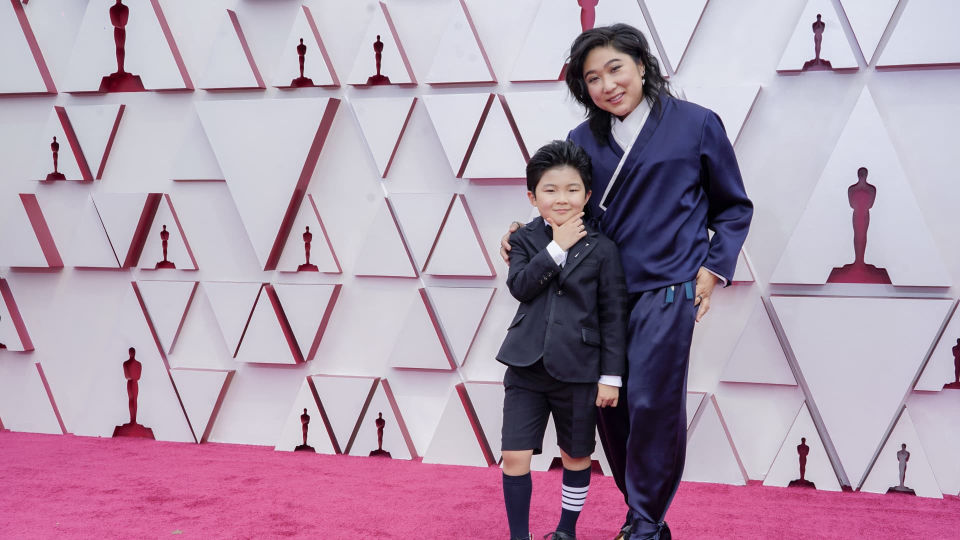 (L-R) Alan S. Kim and Christina Oh attend the 93rd Annual Academy Awards at Union Station on April 25, 2021 in Los Angeles, California.