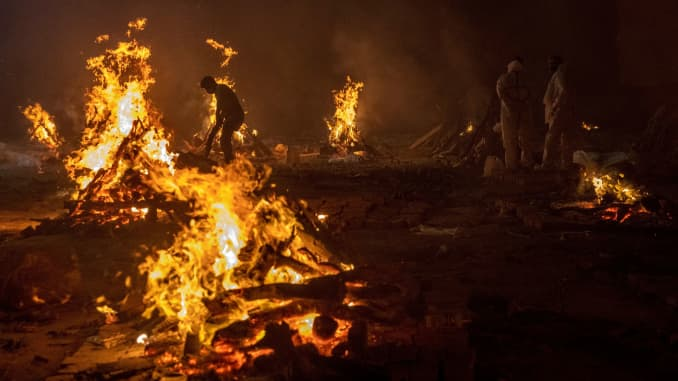 People cremate the bodies of victims of the coronavirus disease (COVID-19), at a crematorium ground in New Delhi, India, April 24, 2021.