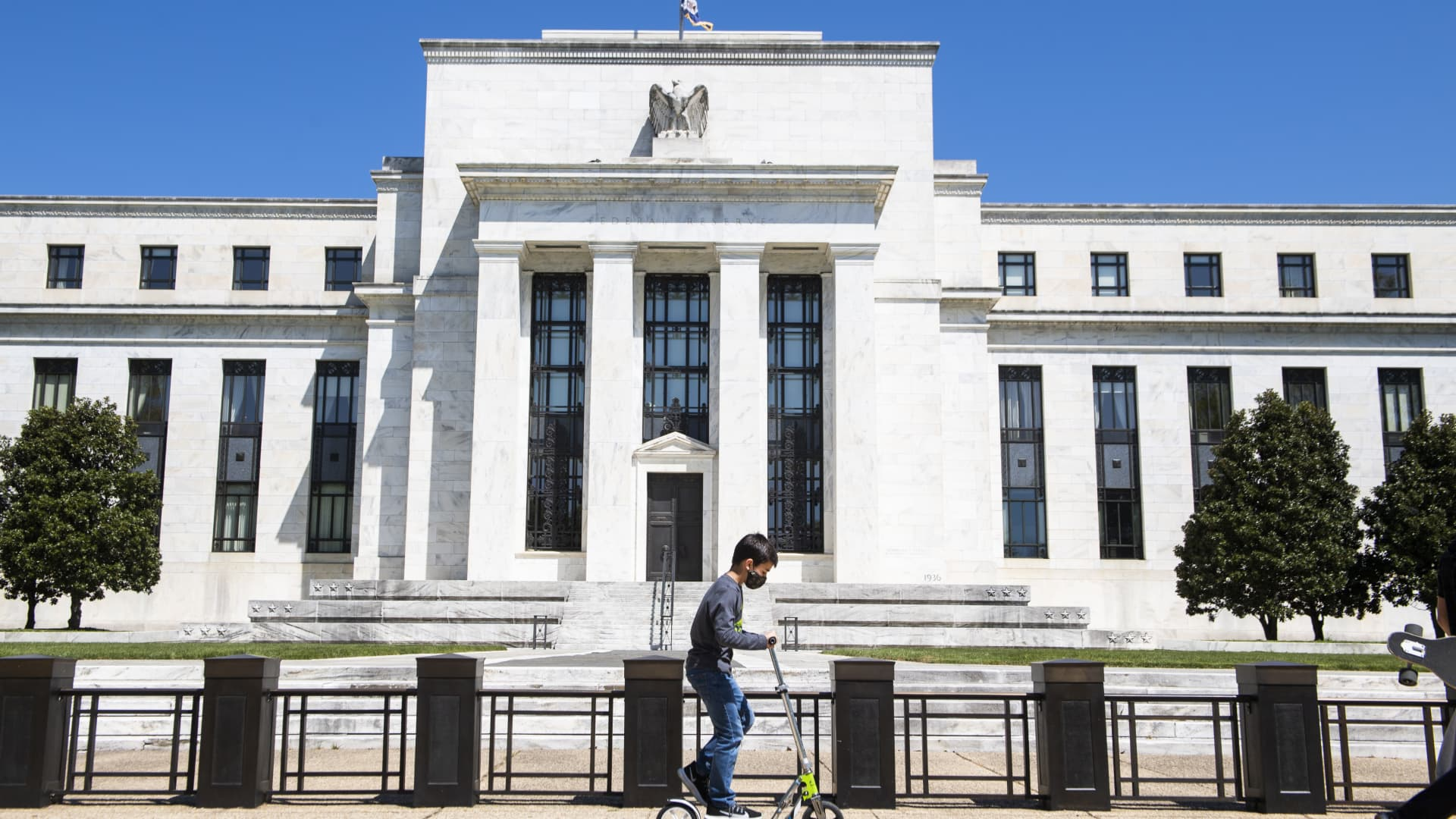 A child passes by the Marriner S. Eccles Federal Reserve Board Building on Constitution Avenue, NW, on Monday, April 26, 2021.