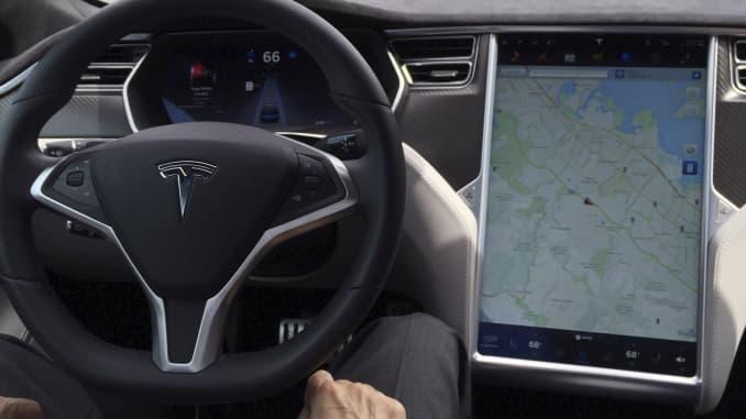 The interior of a Tesla Model S is shown in autopilot mode in San Francisco, California, U.S., April 7, 2016.