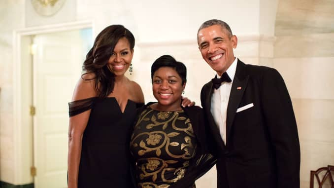 Former White House intern turned Social Secretary Deesha Dyer with the Obamas.