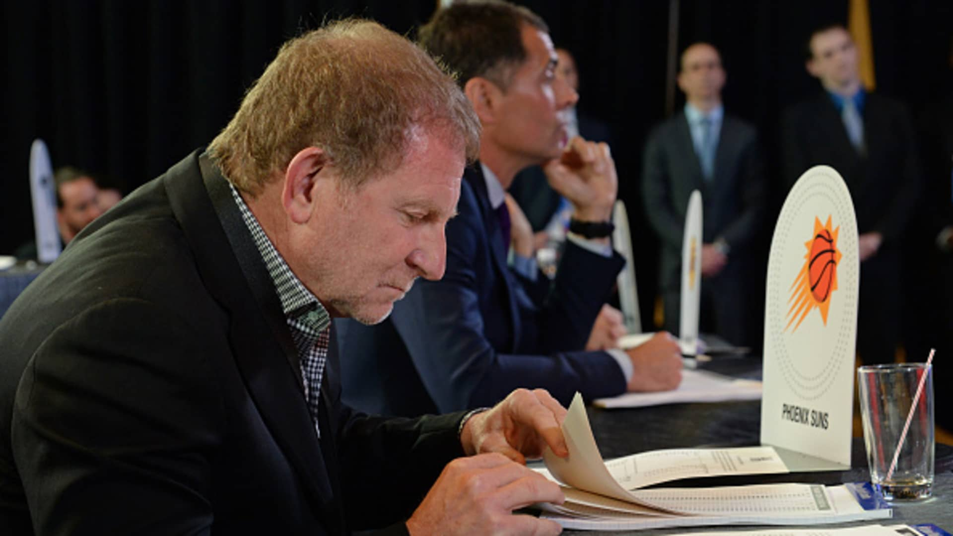 Robert Sarver of the Phoenix Suns takes notes inside the lottery room during the 2017 NBA Draft Lottery at the New York Hilton in New York, New York.