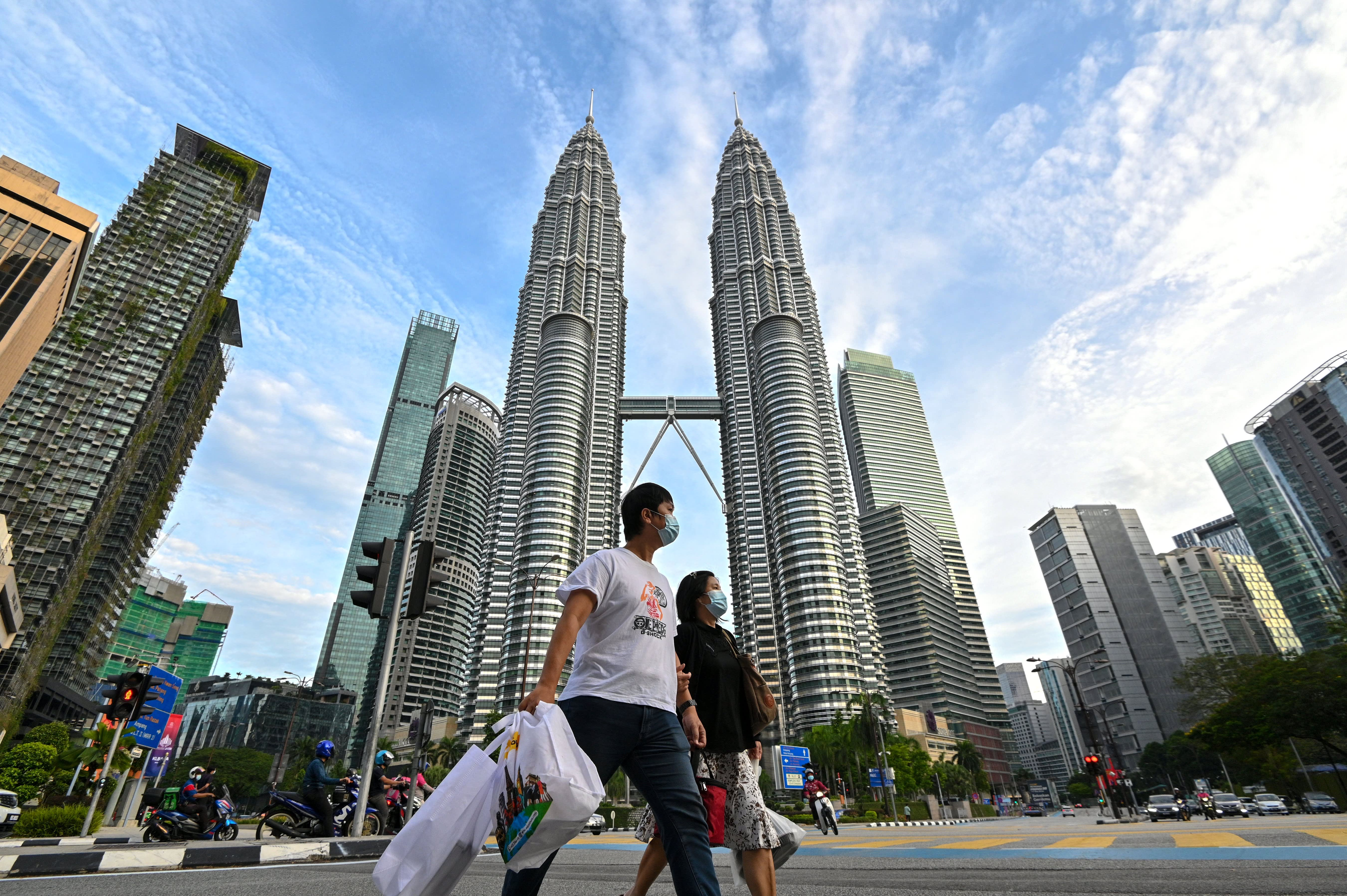 Malaysia will start treating Covid as 'endemic' around end-October, trade minister says