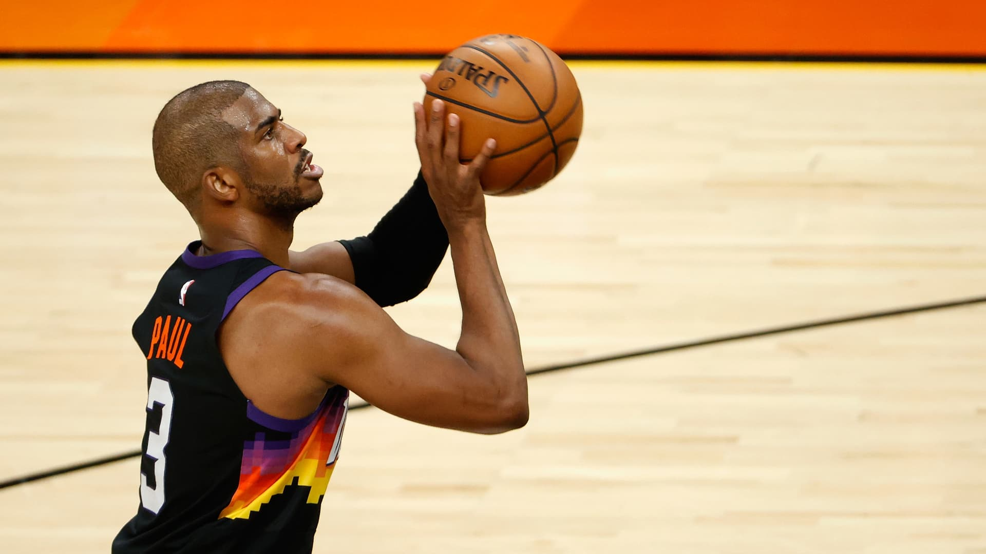 Chris Paul #3 of the Phoenix Suns shoots a free-throw shot against the LA Clippers during the NBA game at Phoenix Suns Arena on April 28, 2021 in Phoenix, Arizona.