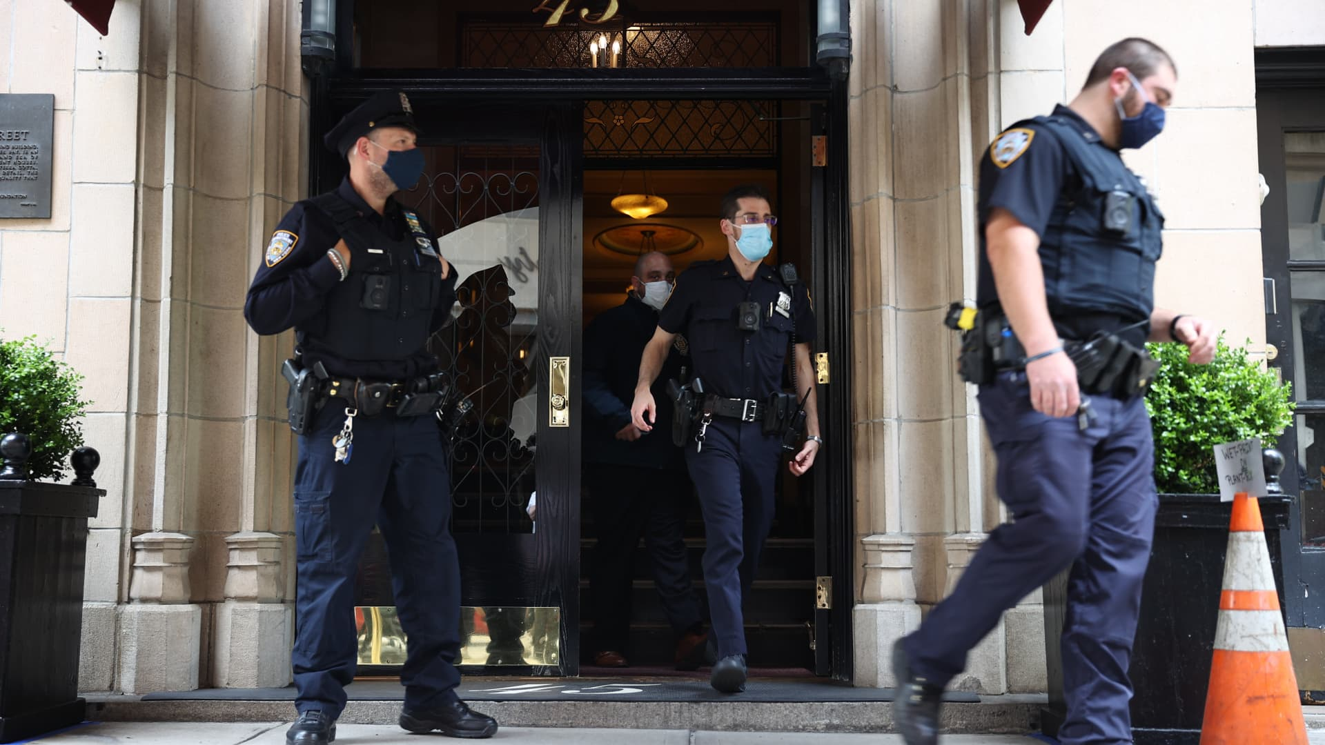 New York City Police officers investigate at the building where home of former President Donald Trump's personal attorney and the former mayor of New York City Rudy Giuliani located after FBI has executed a search warrant at Giulianiâs apartment in Manhattan of New York City, United States on April 28, 2021.