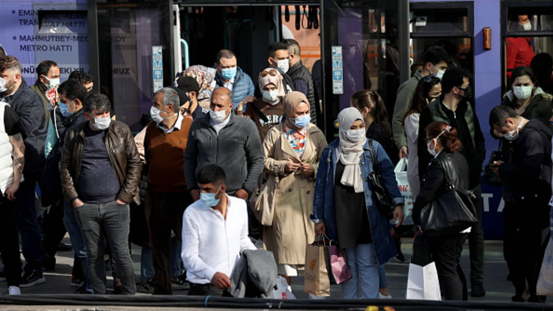 ISTANBUL, TURKEY - APRIL 29: People wait in a queue at Cevizlibag district to get on metrobuses and trams to return their homes ahead of full lockdown from Thursday evening until May 17 to stem the spread of coronavirus in Istanbul, Turkey on April 29, 2021. (Photo by Isa Terli/Anadolu Agency via Getty Images)