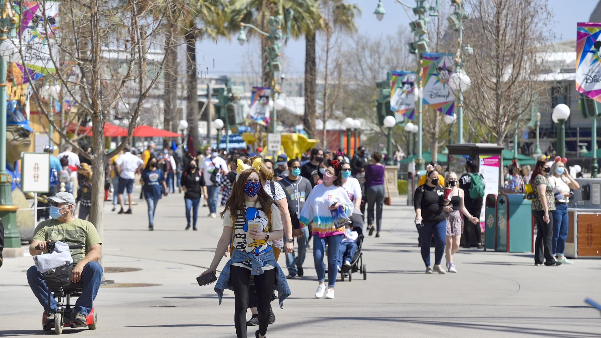 Visitors walk along Paradise Gardens Park during Touch of Disney at Disney California Adventure in Anaheim, CA, on Thursday, March 18, 2021.