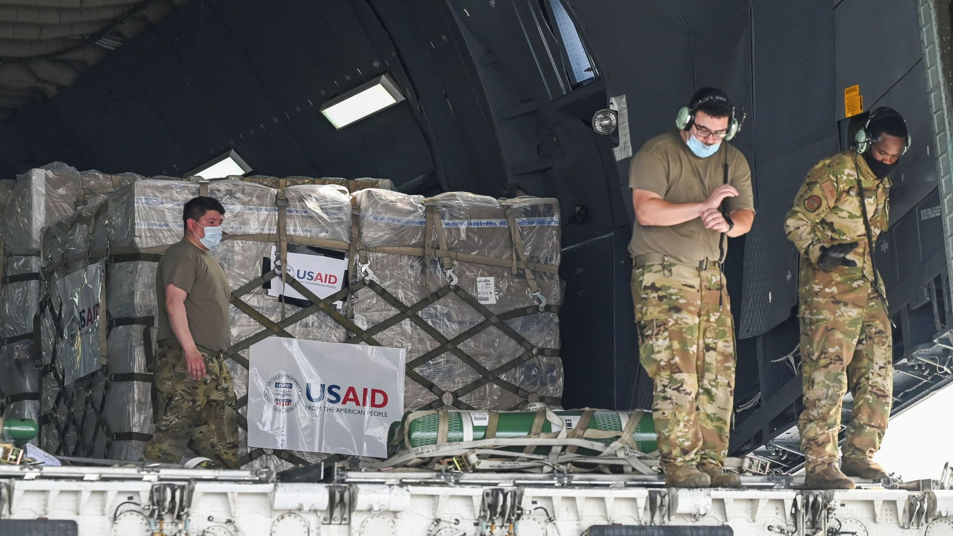 U.S. army personnel prepare to unload coronavirus disease (COVID-19) relief supplies from the U.S. at the Indira Gandhi International Airport cargo terminal in New Delhi, India April 30, 2021.