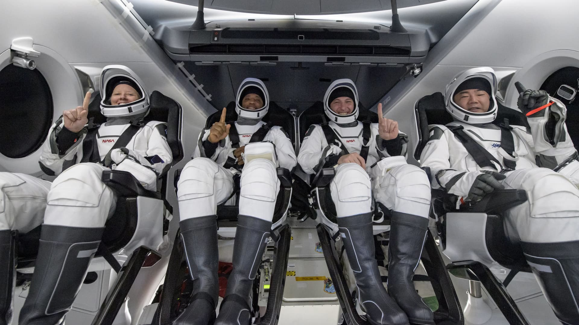 From left: NASA astronauts Shannon Walker, Victor Glover, and Mike Hopkins, and JAXA astronauts Soichi Noguchi inside SpaceX's Crew Dragon capsule 'Resilience' after splashdown on May 2, 2021.