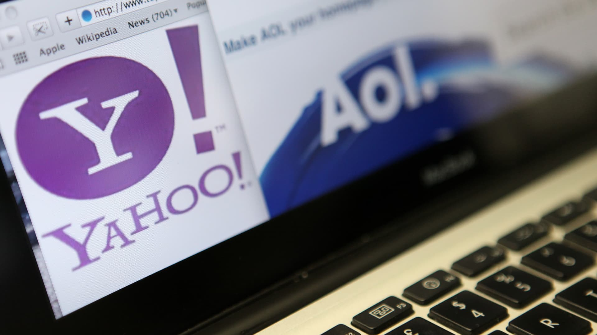 Website pages from Yahoo! Inc., left, and AOL Inc. are displayed on a computer monitor.
