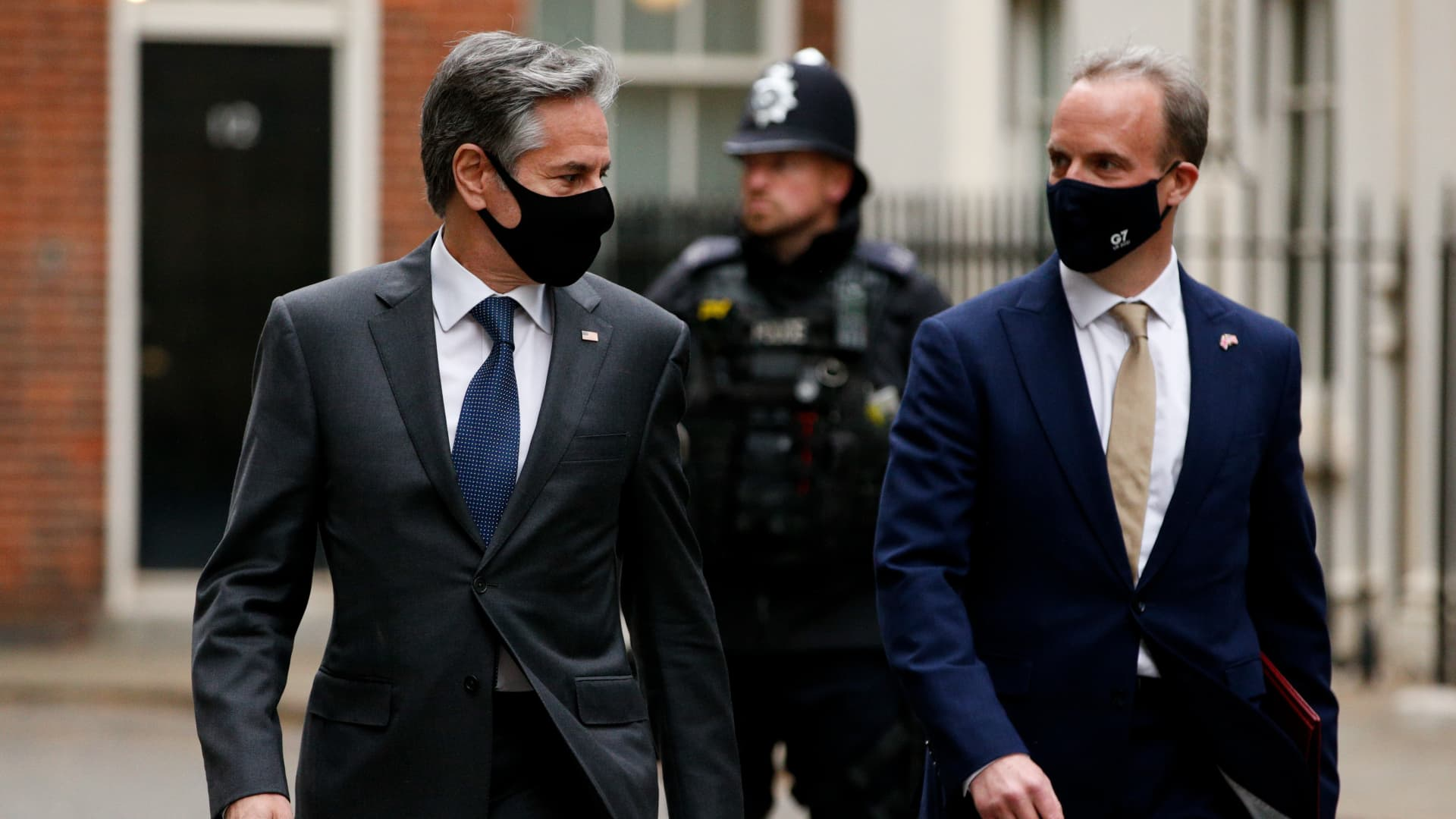 U.S. Secretary of State Antony Blinken (L) and British Foreign Secretary Dominic Raab (R) walk along Downing Street in London, United Kingdom on May 03, 2021.