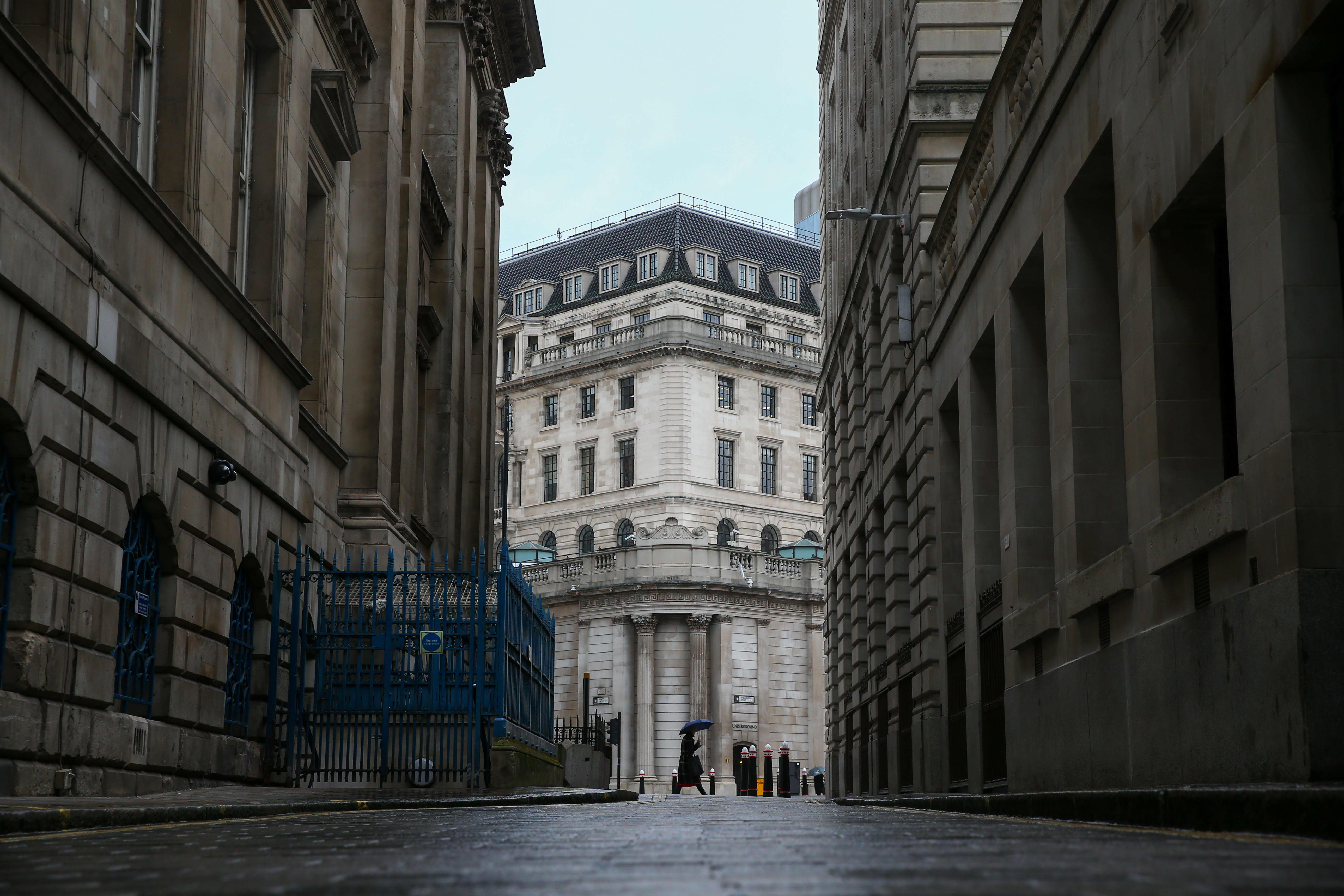 Bank of England holds policy steady, hints at inflation concerns